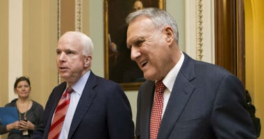In this Dec. 30, 2012, file photo, Sen. John McCain, R-Ariz., left, and Senate Minority Whip Jon Kyl, R-Ariz., leave the chamber.