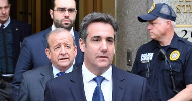 Michael Cohen leaves the U.S. Courthouse in New York and addresses the media after a hearing.