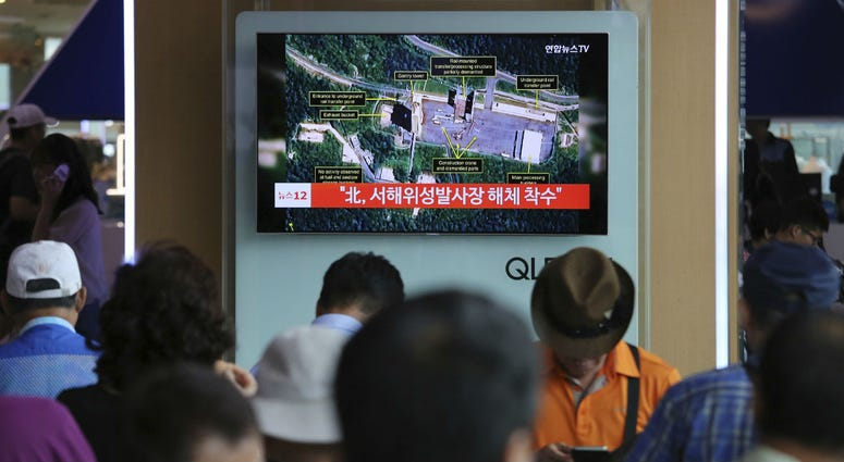 A TV screen shows a satellite image of North Korea's Sohae launch site, during a news program at the Seoul Railway Station in Seoul, South Korea, Tuesday, July 24, 2018.