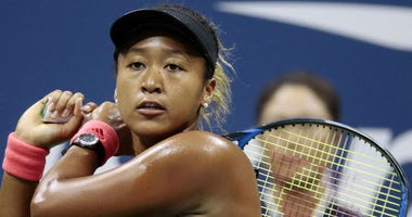 In this Sept. 8, 2018, file photo, Naomi Osaka, of Japan, returns a shot to Serena Williams fo the U.S. during the women's final of the U.S. Open tennis tournament, in New York.