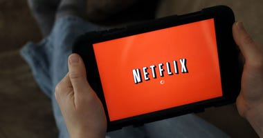 In this Friday, Jan. 17, 2014, file photo, a person displays Netflix on a tablet in North Andover, Mass.