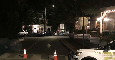 Streets were shut down in New Hope, Pa., after someone was said to have barricaded himself in his apartment, in the background.
