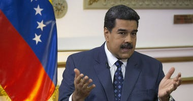 Venezuela's President Nicolas Maduro speaks during an interview with The Associated Press at Miraflores presidential palace in Caracas, Venezuela, Thursday, Feb. 14, 2019.