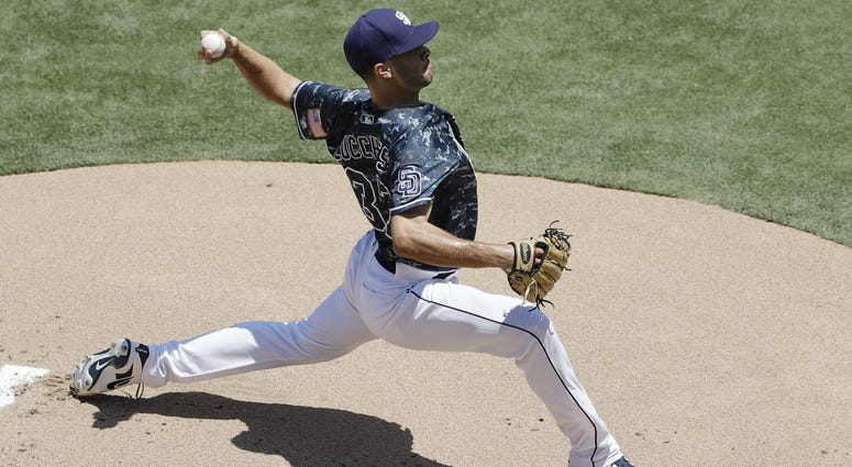 San Diego Padres starting pitcher Joey Lucchesi works against a Philadelphia Phillies batter during the first inning of a baseball game Sunday, Aug. 12, 2018, in San Diego.