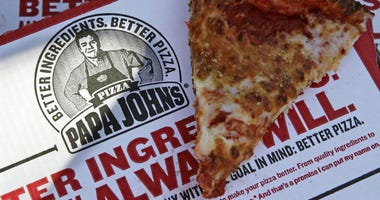 This Dec. 21, 2017, file photo shows a slice of cheese pizza at the Papa John's pizza shop in Quincy, Mass.