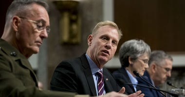 Acting Defense Secretary Patrick Shanahan, second from left, speaks during a Senate Armed Services Committee hearing on Capitol Hill in Washington , Thursday, April 11, 2019, on the proposed Space Force.