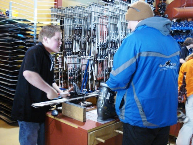 A skier rents skis at the shop.