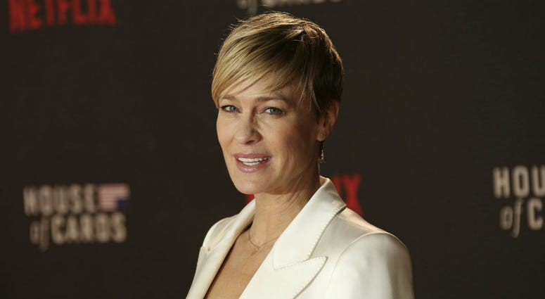 In this Feb. 26, 2015, file photo, Actress Robin Wright poses for photographers upon arrival at the House Of Cards season 3 World Premiere at the Empire Cinema in central London.