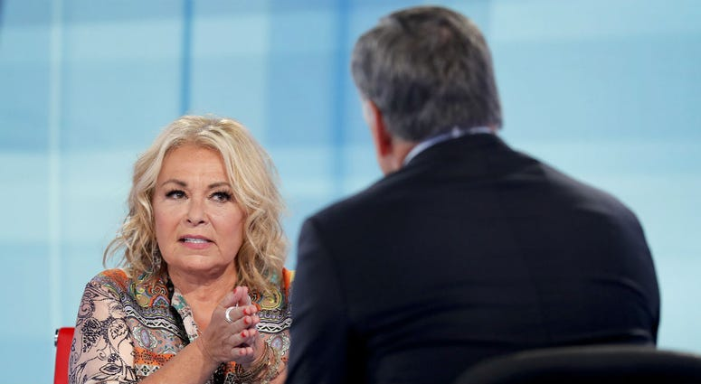 Roseanne Barr talks with Fox News talk show host Sean Hannity while being interviewed during a taping of his show, Thursday, July 26, 2018, in New York.
