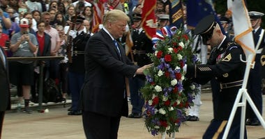 President Trump lays a wreath at Arlington National Cemetery.