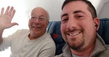 Beaming father Hal Vaughan, left, sits next to fellow passenger Mike Levy on one of his daughter's holiday flights.