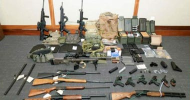 A Coast Guard officer who allegedly stockpiled weapons and wrote a hit list of prominent Democrats and journalists was indicted Wednesday on gun and drug possession charges, the Department of Justice announced in a news release.