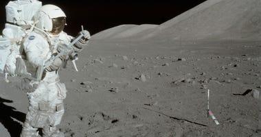 Harrison Schmitt collects lunar rake samples during the first Apollo 17 extravehicular activity.