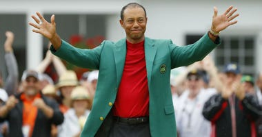 Tiger Woods of the United States smiles after being awarded the Green Jacket during the Green Jacket Ceremony after winning the Masters at Augusta National Golf Club on April 14, 2019 in Augusta, Georgia.