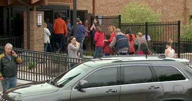 Parents were directed to a recreation center to pick up their children, following a shooting at the STEM School Highlands Ranch in Colorado.