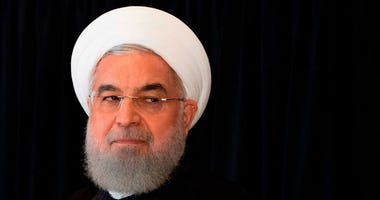 Iran will begin enriching uranium at a higher level than what is allowed under the 2015 nuclear deal within days, Iranian President Hassan Rouhani said Wednesday.