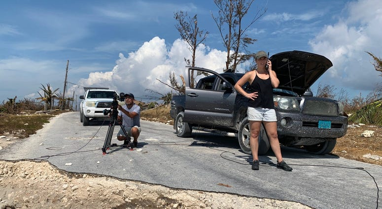 CNN producer Jaide Timm-Garcia and photojournalist Jose Armijo set up for a liveshot from the hard hit town of High Rock in Grand Bahama Island.