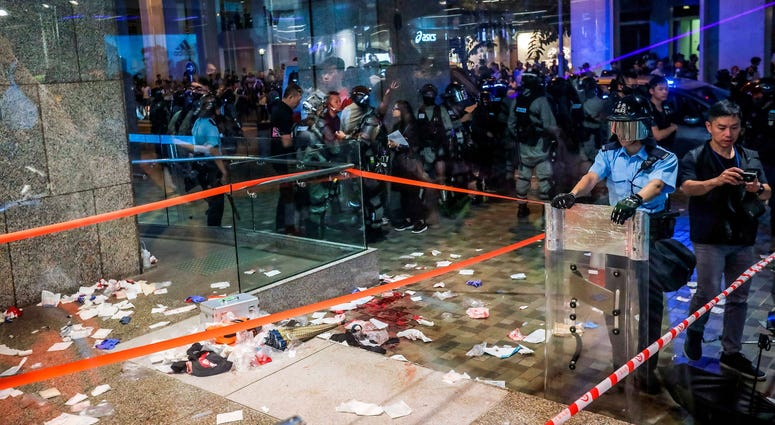 Blood and debris litter the ground of the shopping mall following Sunday's attack.