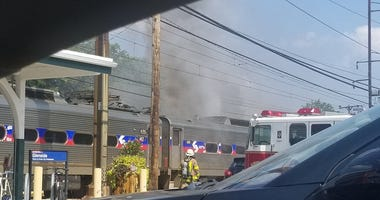 A SEPTA train is on fire at the Glenside station.