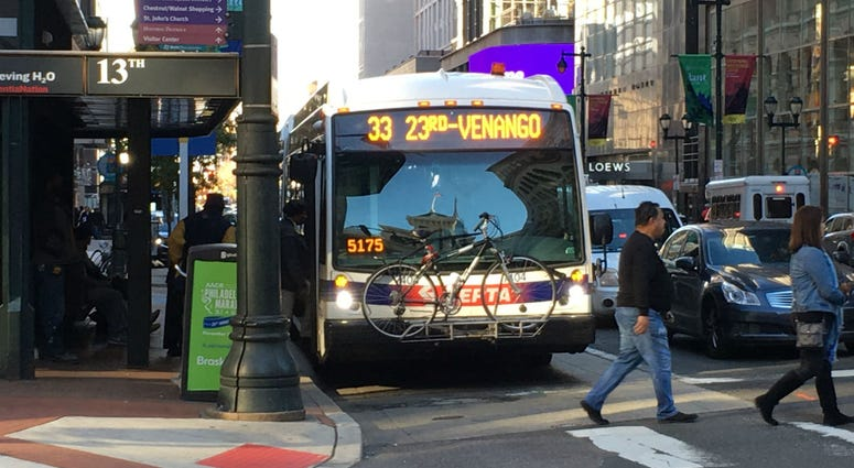 A SEPTA bus heads westward on Market Street.