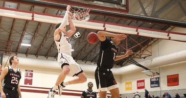 Swarthmore College senior forward Nate Shafer dunks for two.