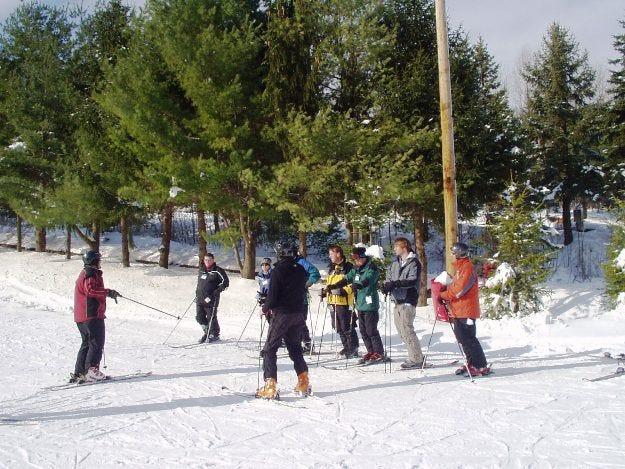 Ski instructors teach participants