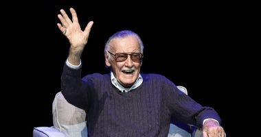 "In this Aug. 22, 2017, file photo, comic book writer Stan Lee waves to the audience after being introduced onstage at the ""Extraordinary: Stan Lee"" tribute event at the Saban Theatre in Beverly Hills, Calif."