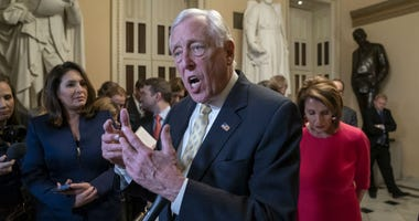 House Majority Leader Steny Hoyer, D-Md., center, and Speaker of the House Nancy Pelosi, D-Calif., push back on President Donald Trump's demand for funding to build a wall on the US-Mexico border.