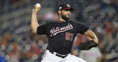 Washington Nationals starting pitcher Tanner Roark delivers a pitch during the third inning of a baseball game against the Philadelphia Phillies, Tuesday, Aug. 21, 2018, in Washington.