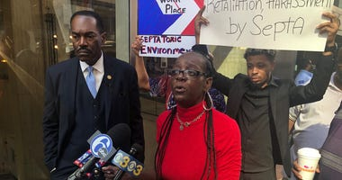 Philadelphia NAACP President Rodney Muhammad and former SEPTA employee Tera Bryant address reporters outside SEPTA headquarters.