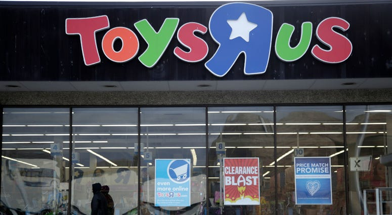This Jan. 24, 2018, file photo shows a person walking near the entrance to a Toys R Us store, in Wayne, N.J.
