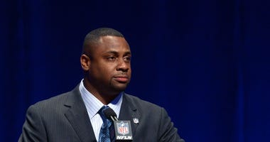 Former Eagles player Troy Vincent speaks during a press conference at Rose Theater.
