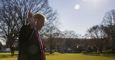 President Donald Trump waves as he departs after speaking on the South Lawn of the White House as he walks to Marine One, Sunday, Jan. 6, 2019, in Washington. Trump is en route to Camp David.