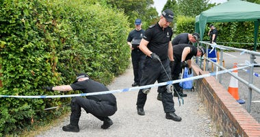 Police conduct searches of Queen Elizabeth Gardens, Salisbury, where Dawn Sturgess visited before she fell ill after coming into contact with Novichok.