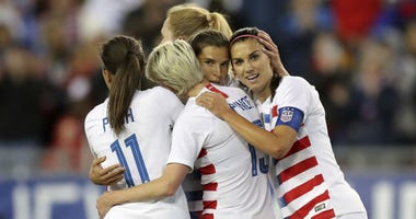 United States' Tobin Heath, second from right, is congratulated on her goal by Mallory Pugh (11), Megan Rapinoe and Alex Morgan (13) during the first half of a SheBelieves Cup soccer match against Brazil Tuesday, March 5, 2019, in Tampa, Fla.
