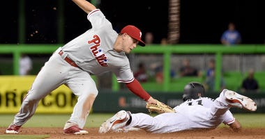 Philadelphia Phillies second baseman Scott Kingery tags out Miami Marlins catcher J.T. Realmuto at second base in the sixth inning at Marlins Park.