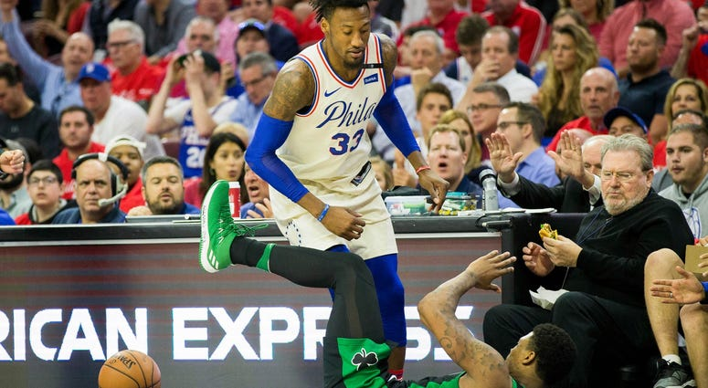 Philadelphia 76ers forward Robert Covington (33) fouls Boston Celtics guard Marcus Smart (36).