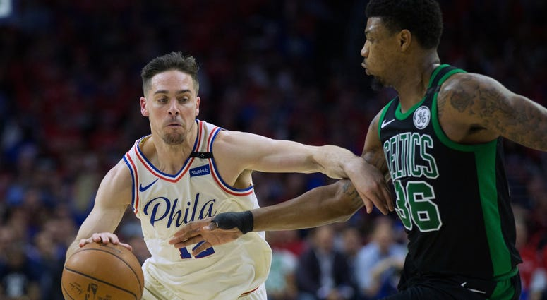 Philadelphia 76ers guard T.J. McConnell (12) dribbles against Boston Celtics guard Marcus Smart (36) during the first quarter in game four of the second round of the 2018 NBA Playoffs.