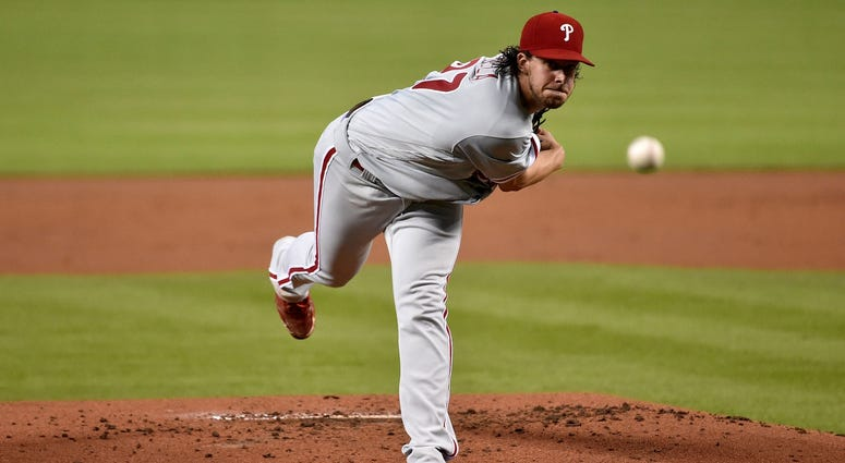 Philadelphia Phillies starting pitcher Aaron Nola (27) delivers a pitch in the first inning against the Miami Marlins at Marlins Park.