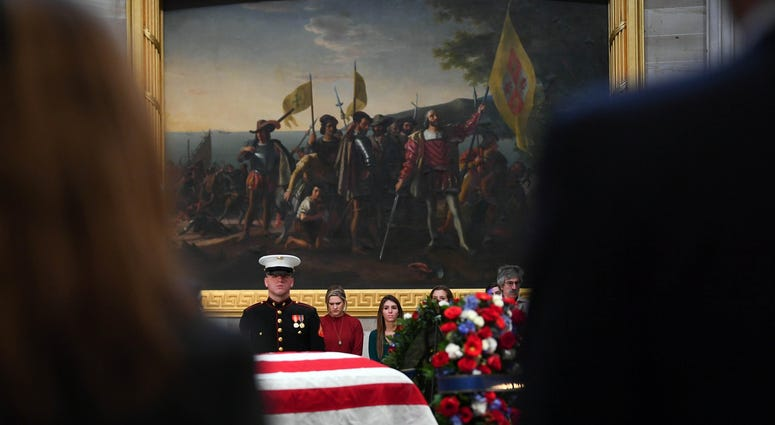 Dec 4, 2018; Washington, DC, U.S.A; Visitors to the Capitol Rotunda pay respects to President George H.W. Bush as he lies in state at the U.S. Capitol Rotunda.