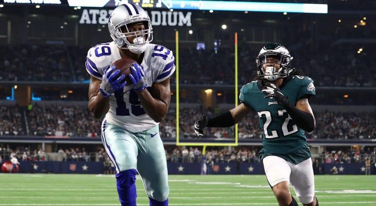 Dallas Cowboys receiver Amari Cooper (19) catches a fourth quarter touchdown pass against Philadelphia Eagles cornerback Sidney Jones (22) at AT&T Stadium, Dec. 9, 2018.