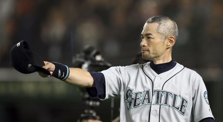 Seattle Mariners right fielder Ichiro Suzuki (51) tips his cap after being removed from the game during the eighth inning against the Oakland Athletics at Tokyo Dome.