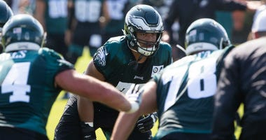 Jul 26, 2019; Philadelphia, PA, USA; Philadelphia Eagles offensive tackle Andre Dillard (77) runs drills during training camp at Novacare Complex.