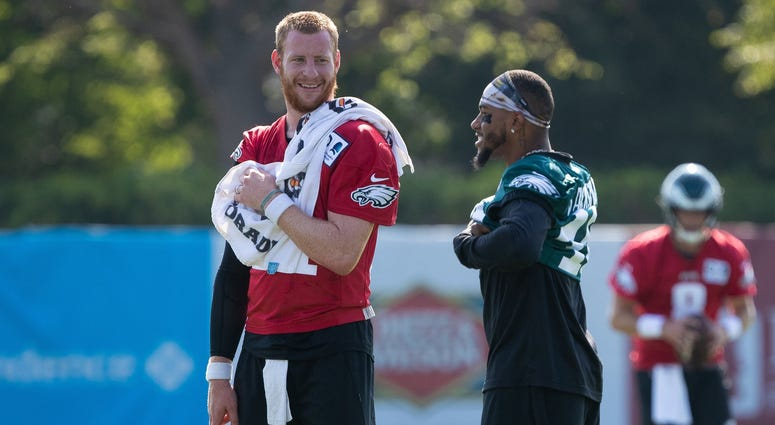 Eagles player DeSean Jackson and Carson Wentz.