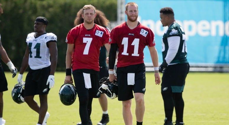 Jul 26, 2019; Philadelphia, PA, USA; Philadelphia Eagles quarterback Carson Wentz (11) and quarterback Nate Sudfeld (7) during training camp at Novacare Complex.