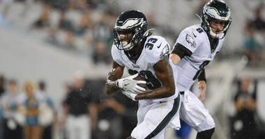 Aug 15, 2019; Jacksonville, FL, USA; Philadelphia Eagles quarterback Clayton Thorson (8) hands the ball off to running back Josh Adams (33) for a touchdown against the Jacksonville Jaguars during the third quarter at TIAA Bank Field.
