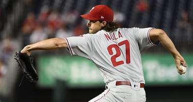 Sep 24, 2019; Washington, DC, USA; Philadelphia Phillies starting pitcher Aaron Nola (27) throws to the Washington Nationals.