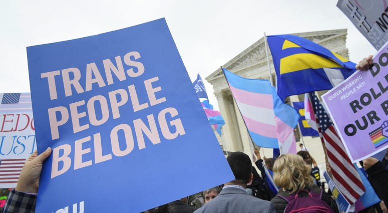 Protestors and supporters gather in front of the U.S. Supreme Court on Oct. 8, 2019 in Washington as the justices hear three challenges from New York, Michigan and Georgia involving workers who claim they were fired because they were gay or transgender.