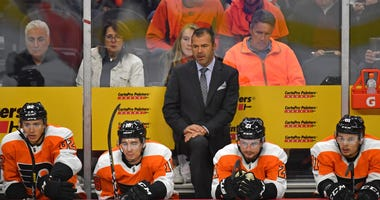 Philadelphia Flyers head coach Alain Vigneault behind the bench against the New Jersey Devils at Wells Fargo Center.