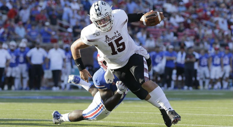 Temple Owls quarterback Anthony Russo (15) scores a touchdown in the fourth quarter against the Southern Methodist Mustangs at Gerald J. Ford Stadium.
